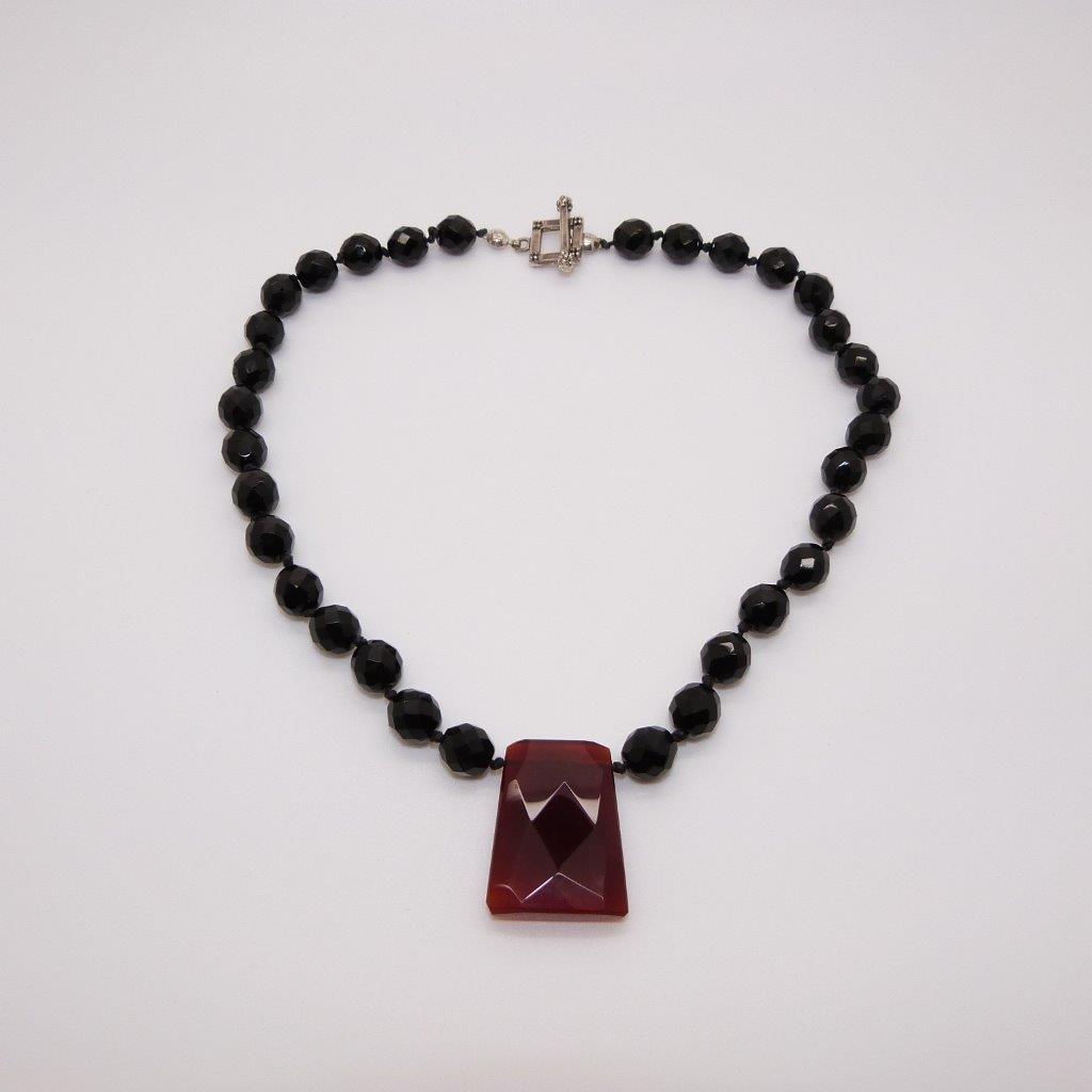 £22.00 - Classy Black Glass Bead Necklace with Cornelian Faceted Cut Drop Pendant