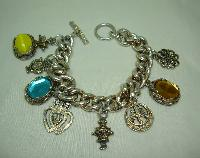 1950s Unique and Fabulous Chunky Glass and Goldtone Charm Bracelet