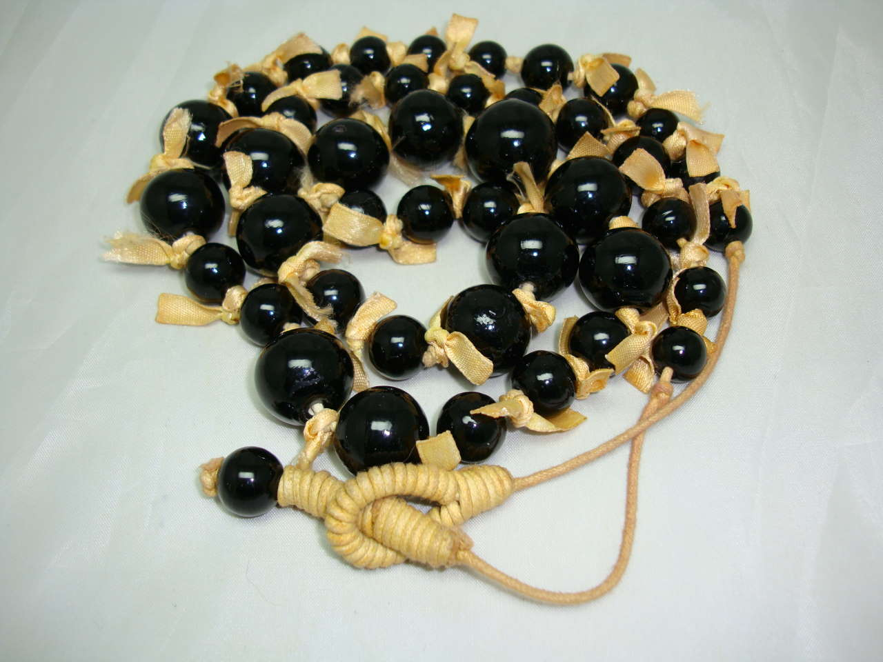 1970s Style Long Black Glass Bead Necklace with Bows!