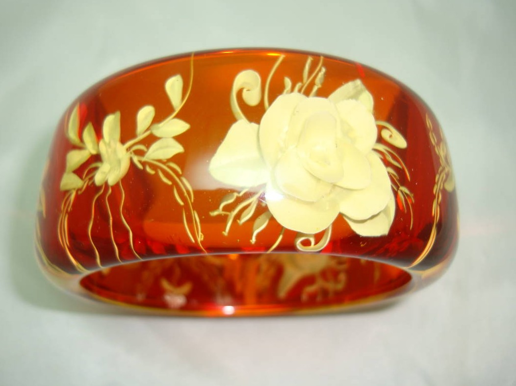 1950s Style Chunky Clear Amber  Lucite Reverse Carved Flower Bangle